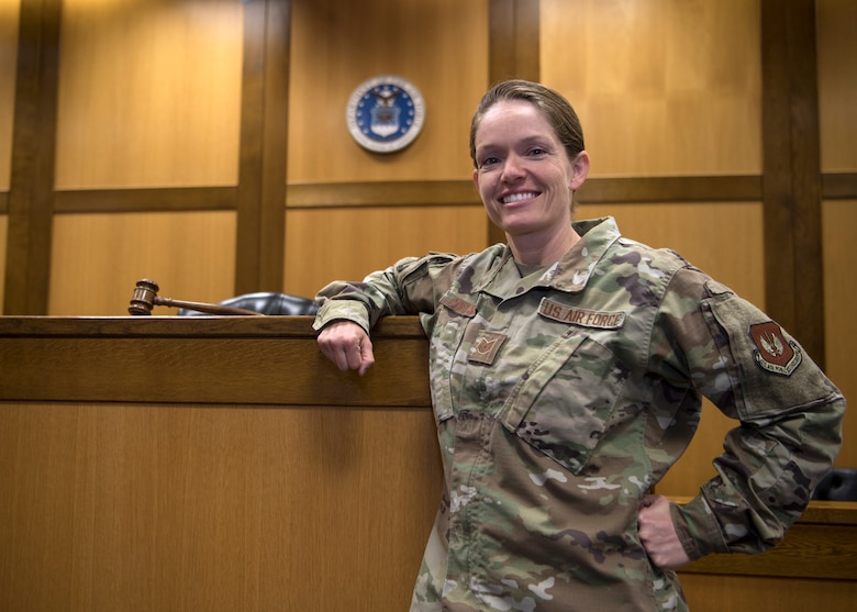 U.S. Air Force Tech. Sgt. Amber Coronado, 86th Airlift Wing Judge Advocate noncommissioned officer in charge of adverse actions, poses for a photo in the 86th AW courtroom at Ramstein Air Base, Germany, Aug. 4, 2020.