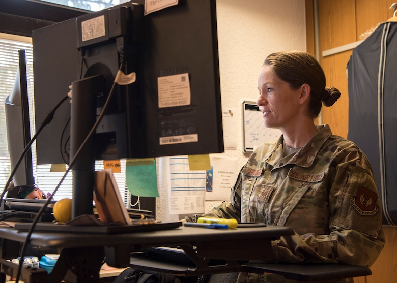 U.S. Air Force Tech. Sgt. Amber Coronado, 86th Airlift Wing Judge Advocate noncommissioned officer in charge of adverse actions, works at her desk at Ramstein Air Base, Germany, Aug. 4, 2020.