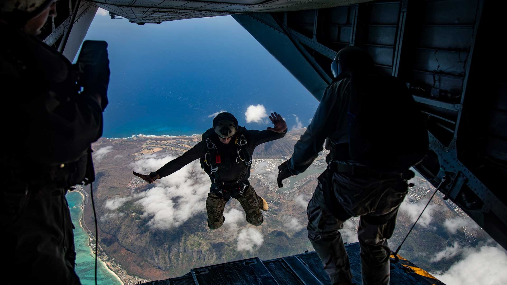 A U.S. Service member with Special Operations Command, Pacific, jumps out of a CH-53E Super Stallion during parachute operations, Marine Corps Training Area Bellows, Marine Corps Base Hawaii, June 19, 2019.