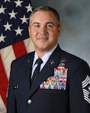 Command Chief Shawn Aiello takes his official photo at Cannon AFB.