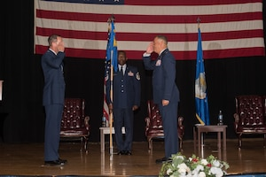 Lt. Col. Carlos Colon, 22nd Force Support Squadron outgoing commander, right, relinquishes command during a change of command ceremony Aug. 6, 2020, at McConnell Air Force Base, Kansas. Colon served as the 22nd FSS commander for two years and will continue to serve at Kirtland Air Force Base, New Mexico, where he will be the Inspection Agency's director of Mission Support. (U.S. Air Force photo by Airman 1st Class Marc A. Garcia)