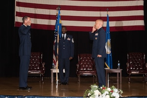 Lt. Col. Matthew Dunn, 22nd Force Support Squadron incoming commander, right, assumes command during a change of command ceremony Aug. 6, 2020, at McConnell Air Force Base, Kansas. Dunn will ensure the 22nd FSS will continue to ready Airmen and their families through the variety of their services. Dunn was formerly General Officer Assignments and Utilization chief at the Pentagon, Washington, D.C., before assuming command of the 22nd FSS. (U.S. Air Force photo by Airman 1st Class Marc A. Garcia)