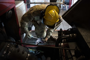 Airman 1st Class Jeff Farrell, 22nd Civil Engineer Squadron fire protection apprentice, checks the power steering fluid during a morning truck checkout Aug. 4, 2020, at McConnell Air Force Base, Kansas. During these daily checks, firefighters ensure everything from the hose nozzles on the truck to the items in their first aid kit are ready for an emergency call at a moment's notice. (U.S. Air Force photo by Senior Airman Alexi Bosarge)