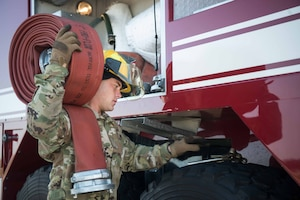 Airman 1st Class Jeff Farrell, 22nd Civil Engineer Squadron fire protection apprentice, prepares to refill the water tank on an aerospace protection aircraft rescue firetruck Aug. 4, 2020, at McConnell Air Force Base, Kansas. The large diameter supply hose that Farrell used is 50 feet long allowing him to fill the AP-23 ARFF truck which can hold up to 3,300 gallons of water. (U.S. Air Force photo by Senior Airman Alexi Bosarge)