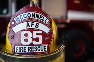 The helmet of a McConnell Air Force Base firefighter sits in Fire Station 1 Aug. 4, 2020, at McConnell AFB, Kansas. McConnell's fire department team currently has 15 deployed members but is still able to fully support and continue to protect the installation from any emergency that comes their way. (U.S. Air Force photo by Senior Airman Alexi Bosarge)