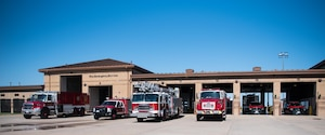 Firetrucks await an emergency call outside Fire Station 1 Aug. 4, 2020, at McConnell Air Force Base, Kansas. McConnell's fire department is staffed with 15 firefighters at all times to ensure that all of Team McConnell is safe 24/7. (U.S. Air Force photo by Senior Airman Alexi Bosarge)