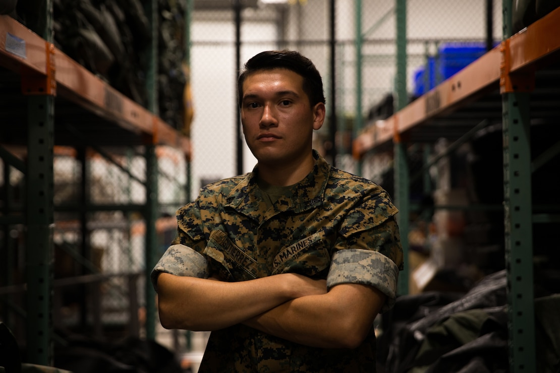 "Cpl. Daniel Gutierrez, the warehouse chief corporal for 2d Air-Naval Gunfire Liaison Company, II Marine Expeditionary Force Information Group, poses for a photo on Camp Lejeune, N.C., August 6, 2020. ""Lead by example and you will build those around you into valuable assets.,"" said Gutierrez, a Santa Ana, Calif., native. According to his leadership, Gutierrez takes pride in his warehouse and is a motivator for ruck runs. Gutierrez reorganized and inventoried 1.5M worth of gear as well as all SL-3 items. (U.S. Marine Corps photo by Cpl. Stephen Campbell)"