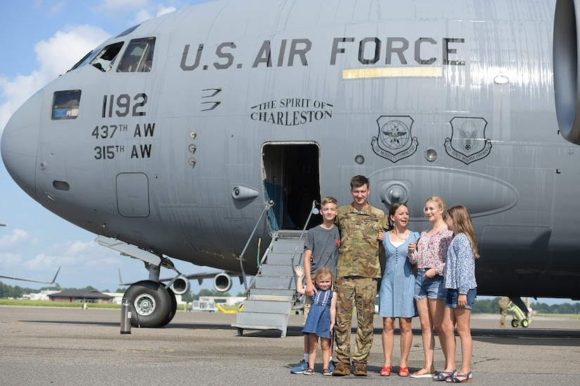 Col. Clinton ZumBrunnen, 437th Airlift Wing commander, and his family pose for a portrait after his fini flight as Airmen at Joint Base Charleston, S.C., Aug. 4, 2020. The fini flight is a military aviation tradition which marks a pilot's retirement from the Air Force. ZumBrunnen Served in the U.S. Air Force for 22 years and accumulated more than 3,000 flight hours as an aviator. (U.S. Air Force Photo by Senior Airman Joshua R. Maund)