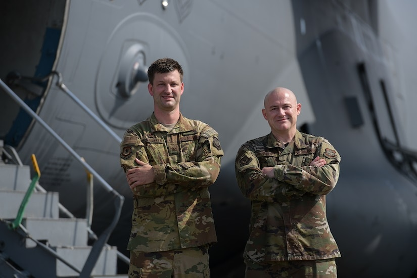 Col. Clinton ZumBrunnen, 437th Airlift Wing commander, left, and Command Chief Master Sgt. Ronnie Phillips, pose for a portrait after their fini flight at Joint Base Charleston, S.C., Aug. 4, 2020 ZumBrunnen Served in the U.S. Air Force for 22 years and accumulated over 3,000 flight hours as an aviator. (U.S. Air Force Photo by Senior Airman Joshua R. Maund)