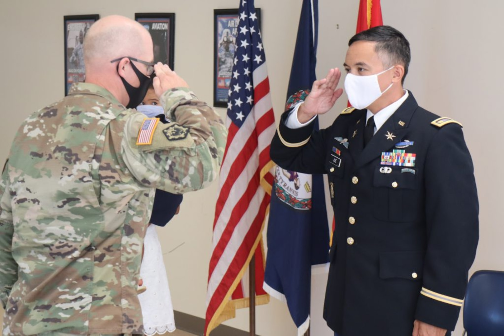 Maj. Gen. Timothy P. Williams, the Adjutant General of Virginia, administers the oath of office to newly-promoted Maj. Waldon W. Jue Aug. July 30, 2020, in Fairfax, Virginia. (U. S. National Guard photo by Cotton Puryear)