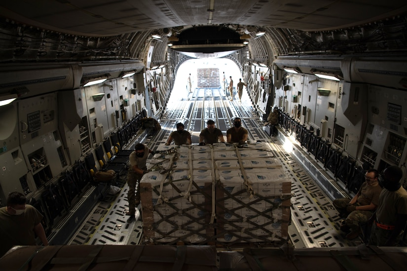 U.S. Air Force Airmen load humanitarian aid supplies onto a U.S. Air Force C-17 Globemaster III at Al Udeid Air Base, Qatar, Aug. 6, 2020, bound for Beirut, Lebanon. U.S. Central Command is coordinating with the Lebanese Armed Forces and U.S. Embassy-Beirut to transport critical supplies as quickly as possible to support the needs of the Lebanese people. (U.S. Air Force photo by Staff Sgt. Justin Parsons)