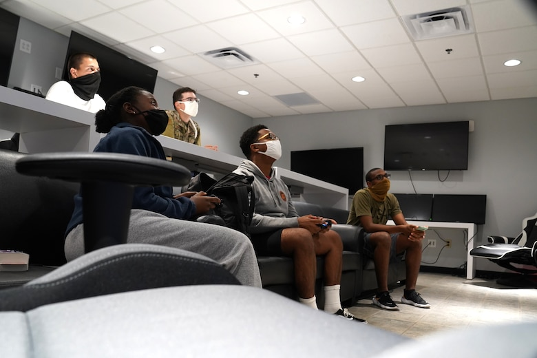 Students from the 81st Training Group play and watch video games in the Fishbowl gaming room inside the Levitow Training Support Facility at Keesler Air Force Base, Mississippi, Aug. 4, 2020. The 81st TRG put the gaming room together to give students the opportunity to interact and build friendships. (U.S. Air Force photo by Airman 1st Class Seth Haddix)