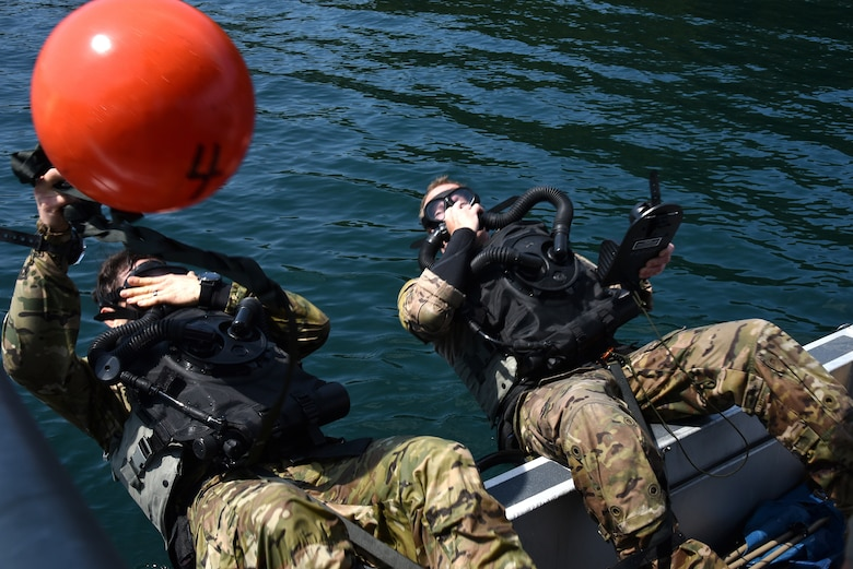 U.S. Air Force 125th Special Tactics Airmen from the Portland Air National Guard Base, along with members of joint forces, participate in closed-circuit dive training at Joint Base Lewis McChord, Wash., July 31, 2020.  Special Tactics operators conducted recurrency dives and training on new equipment.