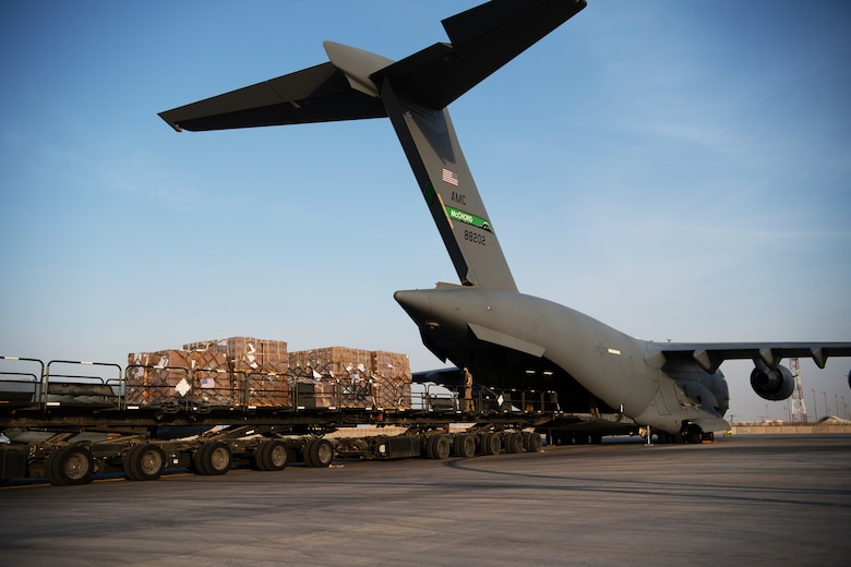 U.S. Air Force Airmen load humanitarian aid supplies onto a U.S. Air Force C-17 Globemaster III at Al Udeid Air Base, Qatar, Aug. 6, 2020, bound for Beirut, Lebanon. U.S. Central Command is coordinating with the Lebanese Armed Forces and U.S. Embassy-Beirut to transport critical supplies as quickly as possible to support the needs of the Lebanese people.