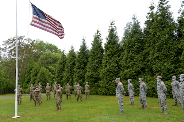 An image of members of the 177th Fighter Wing and 108th Wing, New Jersey Air National Guard, conducting a retreat ceremony May 22, 2020.