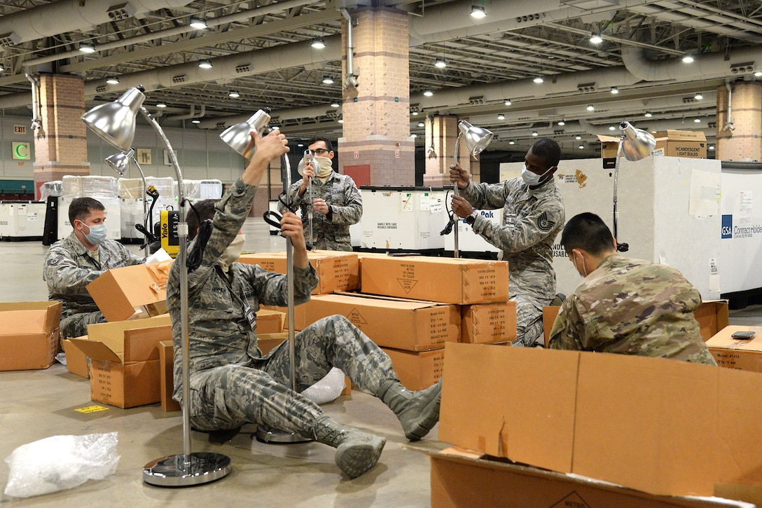 An image of New Jersey National Guardsmen building lamps for a Federal Medical Station at the Atlantic City Convention Center.
