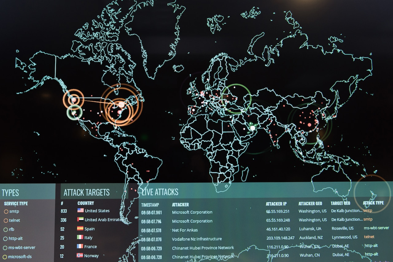 A computer screen shows a map of the globe overlaid with additional information.