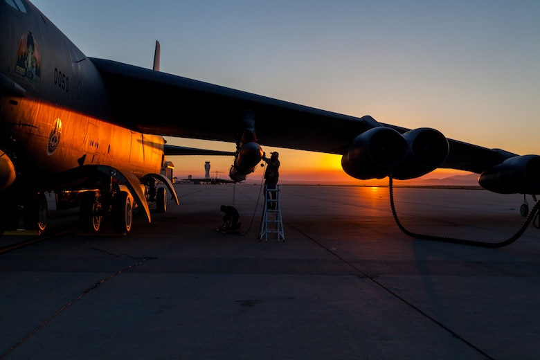 Members of the AGM-183A Air-launched Rapid Response Weapon Instrumented Measurement Vehicle 2 test team make final preparations prior to a captive-carry test flight of the prototype hypersonic weapon at Edwards Air Force Base, California, Aug. 8. (Air Force photo by Kyle Brasier)