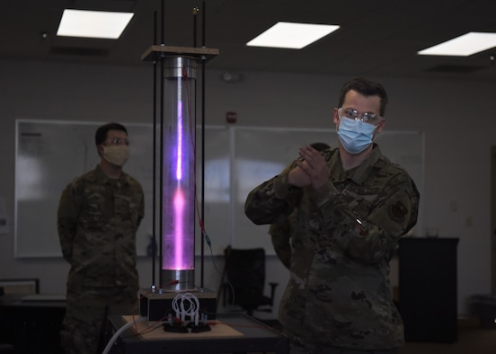 U.S. Air Force Tech. Sgt. David Hunt, 312th Training Squadron Special Instruments Training course instructor, explains different scientific concepts with a student-built plasma chamber, at the Louis F. Garland Department of Defense Fire Academy on Goodfellow Air Force Base, Texas, Aug. 5, 2020. Hunter demonstrated to the SPINSTRA students how volumetric pressure may affect electrons' flow. (U.S. Air Force photo by Airman 1st Class Abbey Rieves)