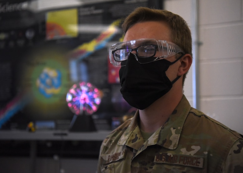 U.S. Air Force Airman 1st Class Hunter Ramsey, 312th Training Squadron Special Instruments Training course student, wears personal protective equipment during the plasma chamber's vacuum demonstration, inside the Louis F. Garland Department of Defense Fire Academy on Goodfellow Air Force Base, Texas, Aug. 5, 2020. The SPINSTRA course was 85 training days and taught electronic principles, applied sciences, computer and network fundamentals, phenomenology, and  Intelligence, Surveillance, and Reconnaissance fundamentals. (U.S. Air Force photo by Airman 1st Class Abbey Rieves)