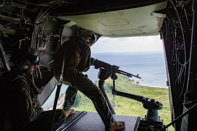 Lance Cpl. Benjamin Carr, a tiltrotor crew chief with Marine Medium Tiltrotor Squadron 262 (Reinforced), 31st Marine Expeditionary Unit, fires an M240 machine gun during a training exercise at a tail gun range off the coast of Okinawa, Japan, July 30, 2020. The training consisted of field carrier landing practice and live firing from an MV-22B Osprey Tiltrotor aircraft. The 31st MEU, the Marine Corps' only continuously forward-deployed MEU, provides a flexible and lethal force ready to perform a wide range of military operations as the premier crisis response force in the Indo-Pacific region. The 31st MEU has implemented strict health protection measures and will continue to conduct mission essential training in support of regional security and stability. (U.S. Marine Corps photo by Lance Cpl. Brienna Tuck)