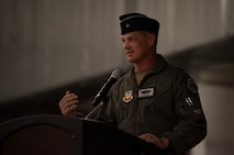 Brig. Gen. Michael Drowley stands at a podium and talks to the crowd during a ceremony.