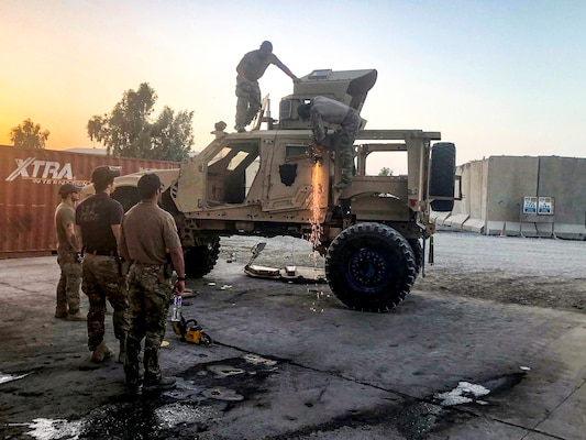 As the sun sets, airmen from the Air Force's 48th Rescue Squadron get the chance to practice their extrication skills in the dark during a July 31 training session at the DLA Disposition Services yard at Kandahar, Afghanistan.