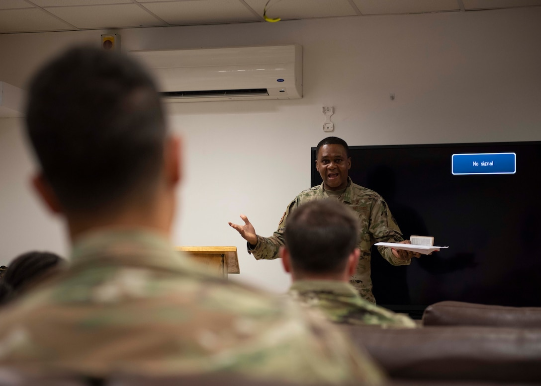 Chaplain officer speaking to group of soldiers