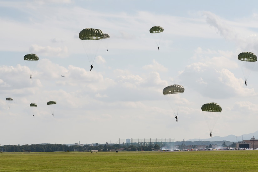 Soldiers parachuting from a C-130 Hercules.
