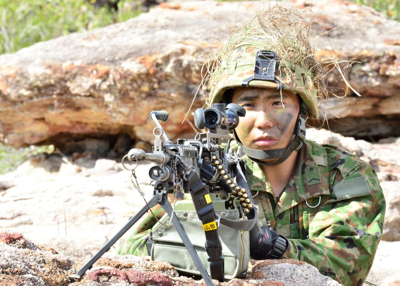 Machine gunner in position.