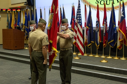 U.S. Marines hold a flag.