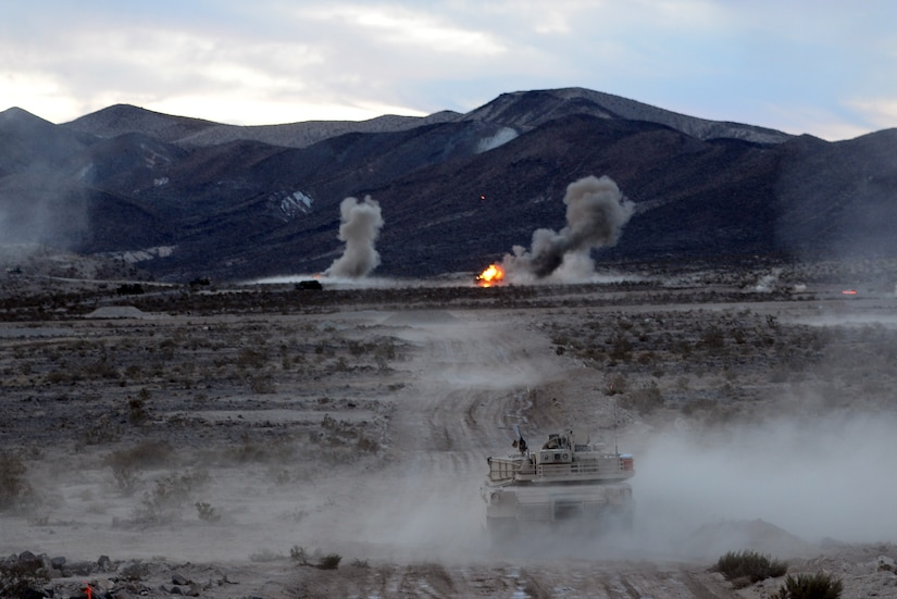 A tank on a firing range shoots at targets.