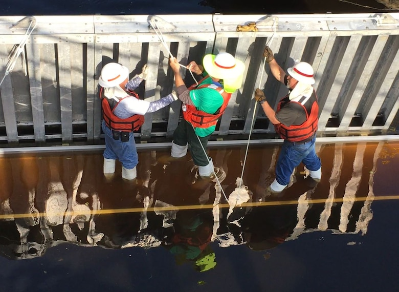 As each needle is added, the crew secures it to the girder.