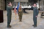 Lt. Col. Thomas Lessner accepts command of the 39th Flying Training Squadron from 340th Flying Training Group Commander Col. Michael Vanzo during the squadron change of command ceremony held Aug. 6 at Joint Base San Antonio-Randolph, Texas. (U.S. Air Force photo by Sean Worrell)