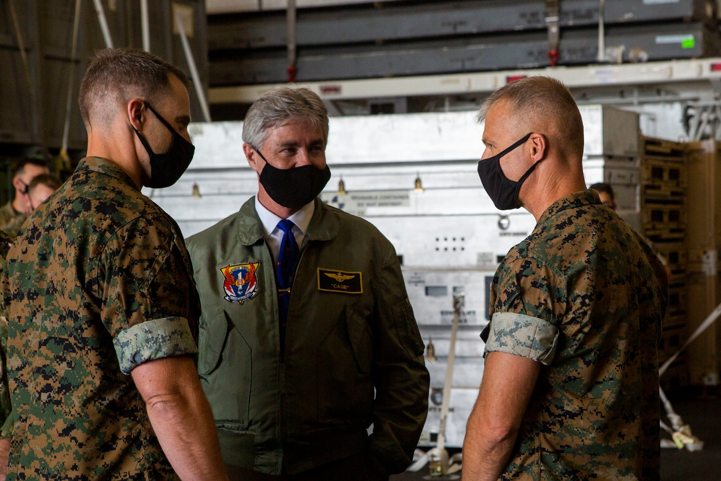 Secretary of the Navy (SECNAV) Kenneth J. Braithwaite speaks with U.S. Marine Corps Col. Christopher Bronzi, commanding officer of the 15th Marine Expeditionary Unit, right, and Maj. Daniel Davis, intelligence officer with the 15th MEU, during his visit to the amphibious assault ship USS Makin Island (LHD 8) in the eastern Pacific.