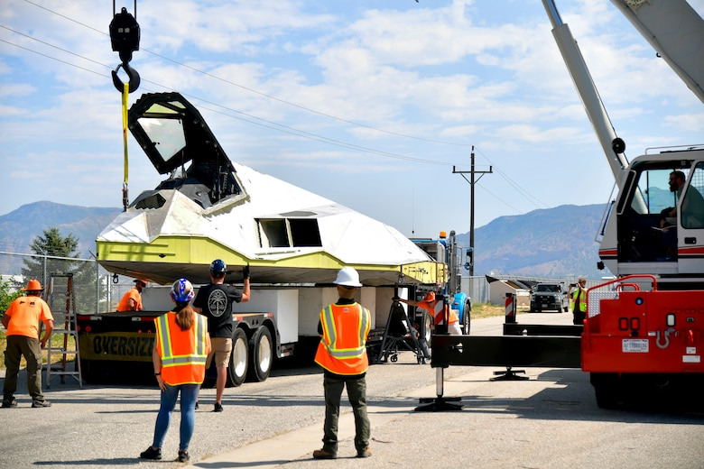 Tonopah Test Range and Hill personnel unload a Lockheed F-117A Aug. 5, 2020, at the Hill Aerospace Museum at Hill Air Force Base, Utah. Tail number 799 was the first operational airframe of a small fleet of 64 stealth aircraft produced and participated in 54 combat sorties in Desert Storm, Allied Force, and Iraqi Freedom. (U.S. Air Force photo by Todd Cromar)