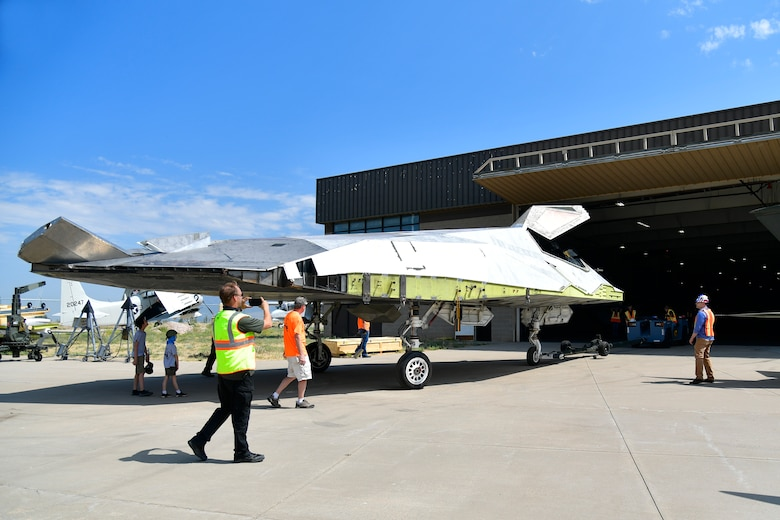 Hill Aerospace Museum personnel position a Lockheed F-117A Aug. 5, 2020, at Hill Air Force Base, Utah. Tail number 799 was the first operational airframe of a small fleet of 64 stealth aircraft produced and participated in 54 combat sorties in Desert Storm, Allied Force, and Iraqi Freedom. (U.S. Air Force photo by Todd Cromar)