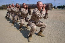 Recruits with Kilo Company, 3rd Recruit Training Battalion, participate in log drills at Marine Corps Recruit Depot, San Diego, Aug. 3, 2020