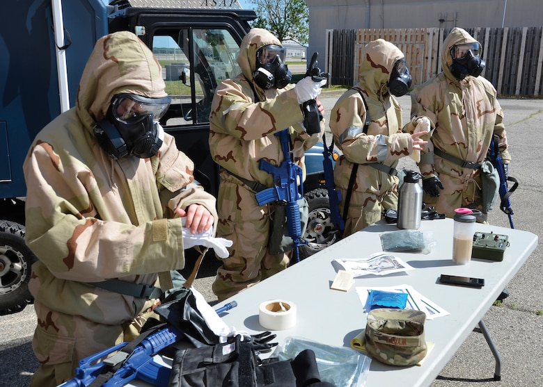 Airmen with the 445th Civil Engineer Squadron's readiness and emergency management flight, remove their protective equipment after completing their training Wright-Patterson Air Force Base, Ohio June 25, 2020. The training saw Airmen plan out routes and determine the best locations to place indicators of airborne threats while maintaining an alert and defensive posture, requiring them to wear Mission Oriented Protective Posture (MOPP) gear. (U.S. Air Force photo/Staff Sgt. Ethan Spickler)