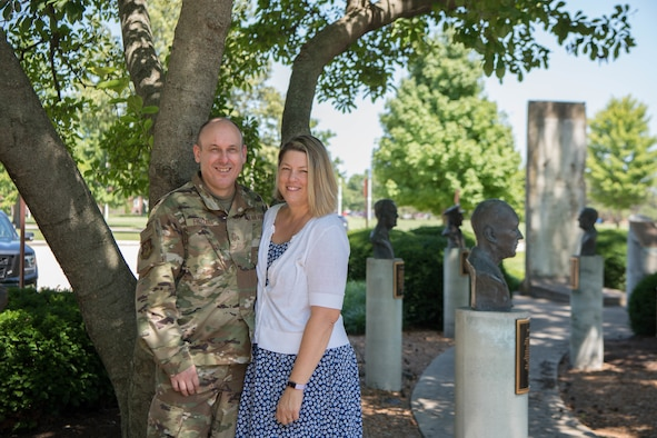 Family photo of Chief Frizzell and his wife Kerri outside of the 375th AMW wing HQ.