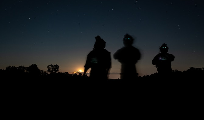 Tactical air control party Airmen assigned to the 113th Air Support Operations Squadron of the 181st Intelligence Wing from the Indiana Air National Guard observe an aircraft during night close air support training at Atterbury Range at the Camp Atterbury Joint Maneuver Training Center, Ind., Aug. 4, 2020. TACPs from the 113th ASOS provide joint terminal attack controller capabilities to air assets to execute military ground commanders' intent.