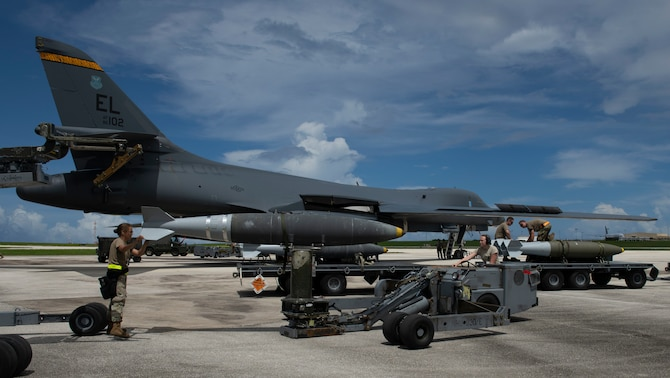 Load crew members, assigned to the 28th Aircraft Maintenance Squadron, 37th Aircraft Maintenance Unit use a munitions lift truck, to load a GBU-38 Joint Direct Attack Munition into a B-1B Lancer, ahead of a 16-hour Bomber Task Force mission to Australia from Andersen Air Force Base, Guam, Aug. 5, 2020. Bomber Task Force maintainers ensure the bombers, equipment, and munitions are ready – anytime, anywhere. (U.S. Air Force photo by Airman 1st Class Christina Bennett)