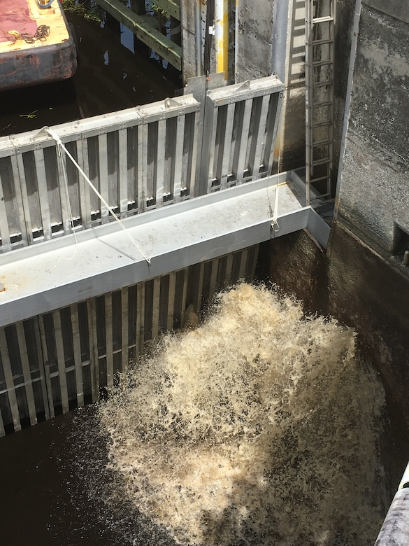 Within a fraction of a second, water rushes in to fill the lock chamber. Though it means that the necessary repairs and inspections have been completed and it's the symbolic end of the dewatering process for the team, there's still a huge amount of work to be done. The needle system still needs to be removed, and all of the equipment must be demobilized.