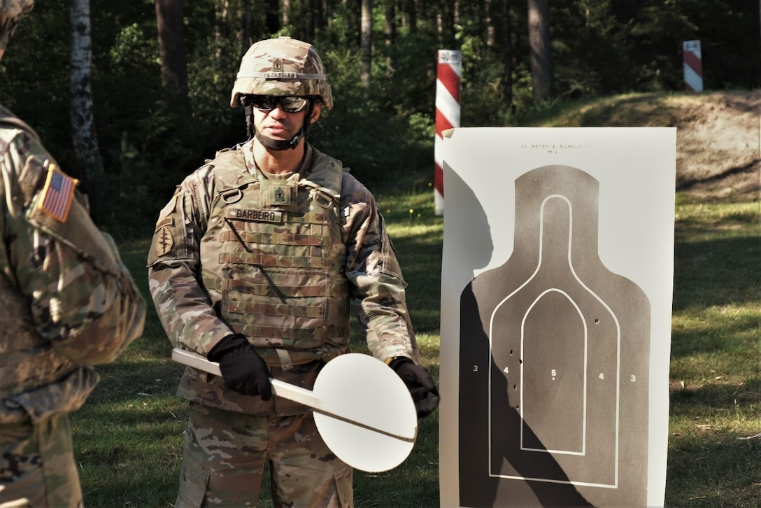 U.S. Army Reserve 1st Sgt. Domenic Barbeiro of the 773rd Civil Support Team, 7th Mission Support Command, conducts range safety operations for the M17 pistol qualification during exercise Forward and Ready 20 at United States Army Garrison Bavaria in Grafenwoehr, Aug. 1, 2020.