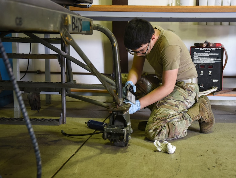 Maintainer Airman fixing a piece of equipment