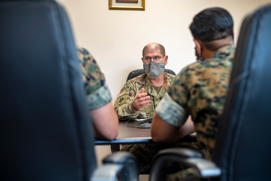 U.S. Army Maj. Derek Butler, a civil liaison officer with Joint Task Force – Bravo, speaks with U.S. Marine Corps civil affairs specialists with Special Purpose Marine Air-Ground Task Force - Southern Command about civil affairs missions at Soto Cano Air Base, Honduras, Aug. 6, 2020. A group of approximately 20 Marines from the SPMAGTF-SC has joined with Joint Task Force - Bravo in support of operations and exercises in the Latin American and Caribbean region. The remainder of the task force is prepared to deploy to the region to work alongside partner nation militaries, enhancing combined crisis response efforts in the U.S. Southern Command area of responsibility. Butler is a native of Houston, Texas. (U.S. Marine Corps photo by Sgt. Andy O. Martinez)