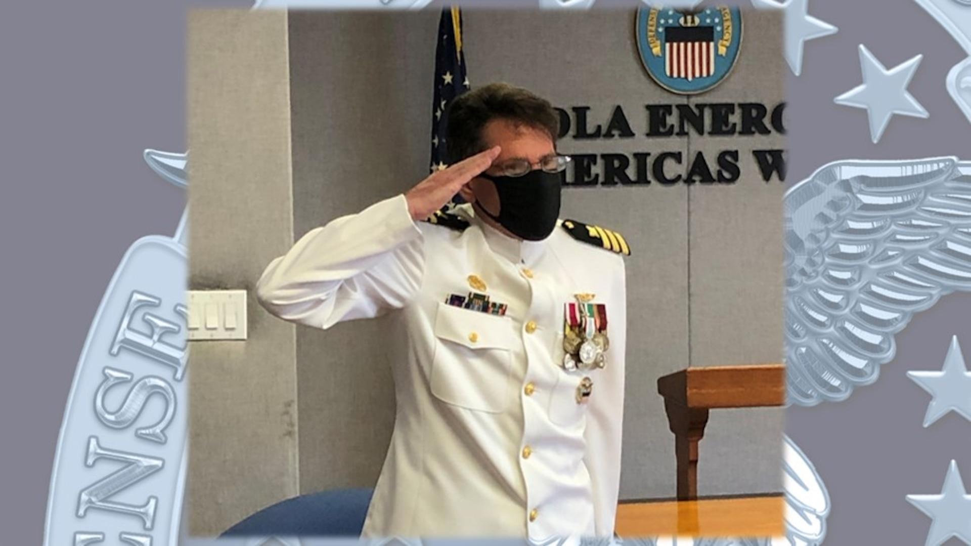 Navy Cmdr. Michael Wilson salutes