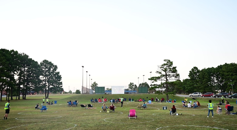 People watch a movie in the base park