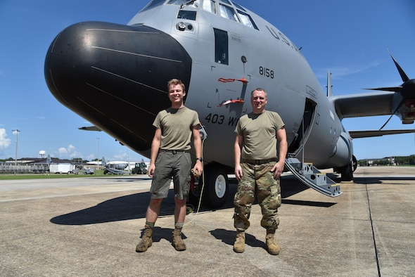 Senior Airman Robert Koltas (left), 403rd Maintenance Squadron propulsion technician, wears the authorized shorts as he stands next to Tech. Sgt. Ben Cox, 403rd MXS propulsion technician (right), in the Operational Camouflage Pattern trousers, July 17, 2020 at Keesler Air Force Base, Mississippi. (U.S. Air Force photo by Tech Sgt. Michael Farrar)