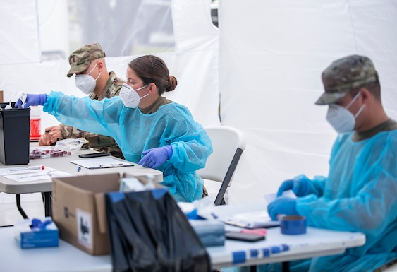 159th Medical Group perform COVID-19 testing with local and state partners.